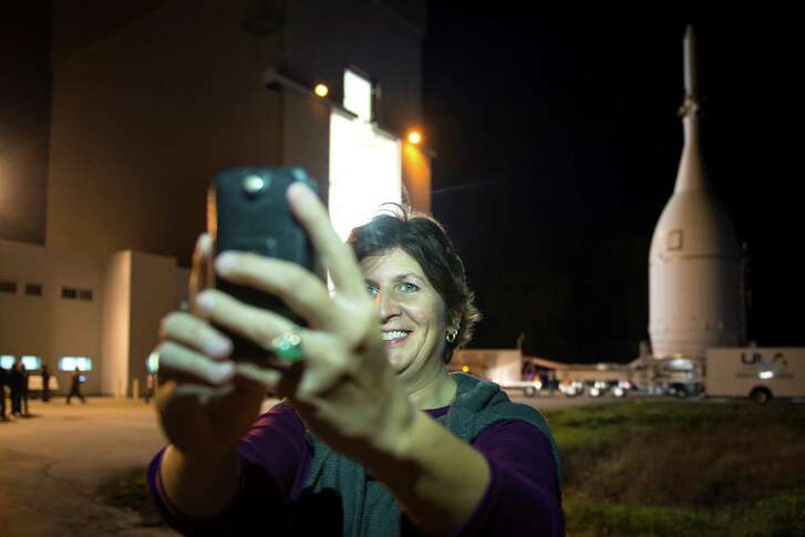 "Chief engineer Julie Kramer takes a selfie with her ""baby"" as the Orion rolls out Nov. 11 in Florida."