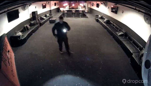 An image off of a  surveillance camera video from the night of November 9, 2014, shows Albany Police in the downstairs area of the Buddha Tea House.   (Paul Buckowski / Times Union) Photo: Paul Buckowski / 00029648A