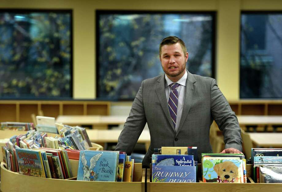 The new director of the Albany Library Scott Jarzombek at the Washington Avenue branch Wednesday afternoon Nov. 12, 2014 in Albany, N.Y.    (Skip Dickstein/Times Union) Photo: SKIP DICKSTEIN / 00029420A
