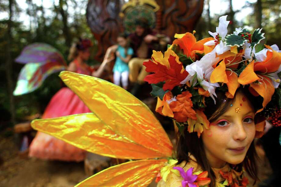 Sophie Deagun plays Flutter Fly the fairy next to Queen Titania and King Oberon, King of the Fairies at the Texas Renaissance Festival Saturday, Nov. 29, 2014, in Todd Mission. Sunday is the last day for the festival this year. Photo: Johnny Hanson, Houston Chronicle / © 2014  Houston Chronicle