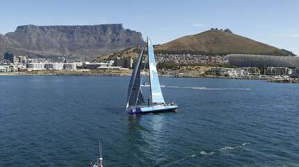 CAPE TOWN, SOUTH AFRICA - NOVEMBER 05: In this handout image provided by the Volvo Ocean Race, Team Vestas Wind acrosses the finsh line in fourth place during the arrivals at the completion of Leg One of the Volvo Ocean Race from Alicante to Cape Town on November 05, 2014 in Cape Town, South Africa. The Volvo Ocean Race 2014-15 is the 12th running of this ocean marathon. Starting from Alicante in Spain on October 11, 2014, the route, spanning some 39,379 nautical miles, visits 11 ports in 11 countries (Spain, South Africa, United Arab Emirates, China, New Zealand, Brazil, United States, Portugal, France, the Netherlands and Sweden) over nine months. The Volvo Ocean Race is the world's premier ocean race for professional racing crews. (Photo by Ainhoa Sanchez/Volvo Ocean Race via Getty Images)