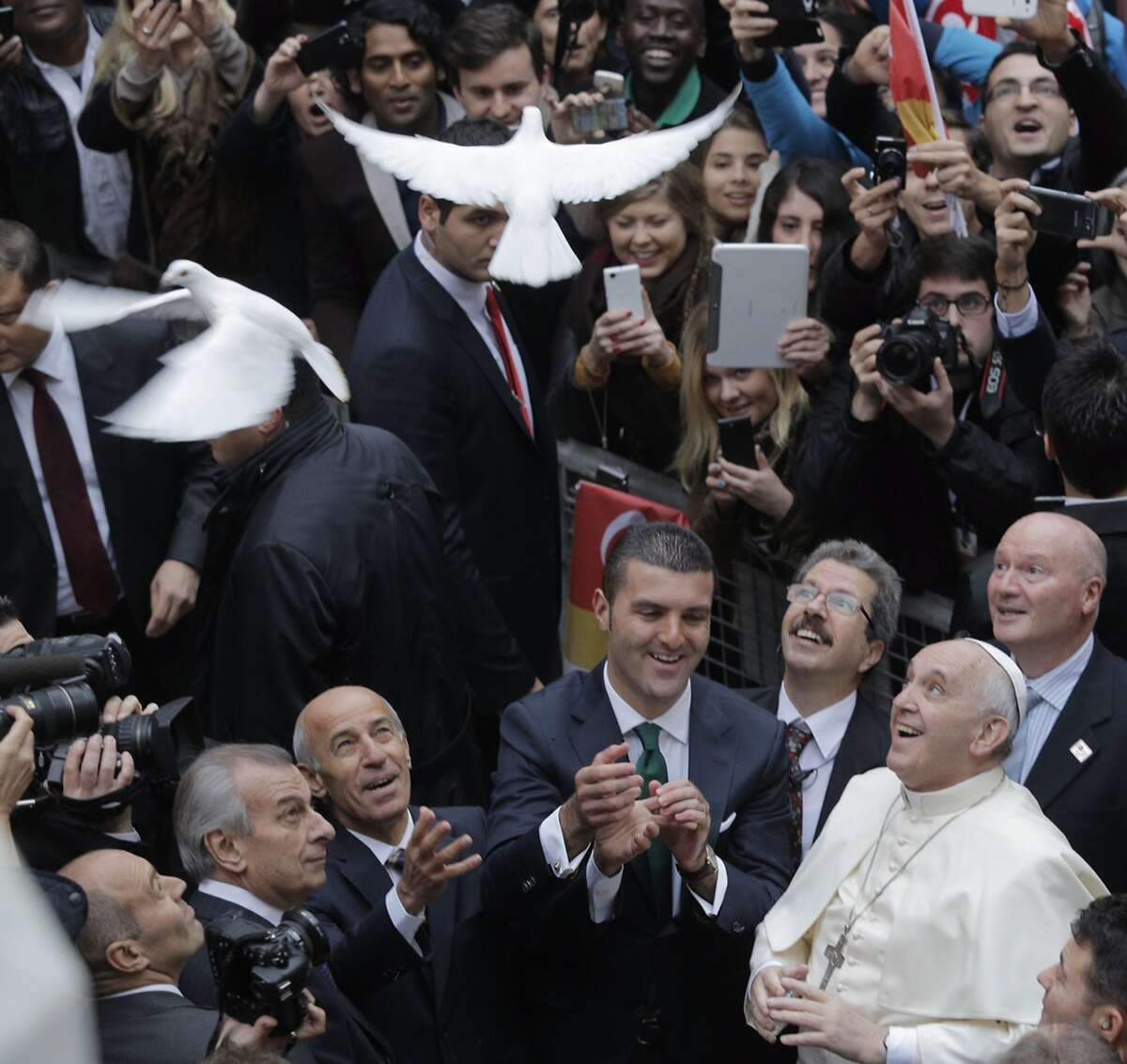 ISTANBUL, TURKEY - NOVEMBER 29: In this handout image provided by the Sisli Municipality Press Office, Pope Francis releases a white dove prior to delivering a Holy Mass at the Catholic Cathedral of the Holy Spirit on November 29, 2014 in Istanbul, Turkey. Pope Francis arrived in Turkey on Friday at a sensitive moment for the Muslim nation, as it cares for 1.6 million refugees and faces the continued threat of the Islamic State group who have been advancing into areas near Turkey's southern border. (Photo by Sisli Municipality Press Office via Getty Images) *** BESTPIX ***