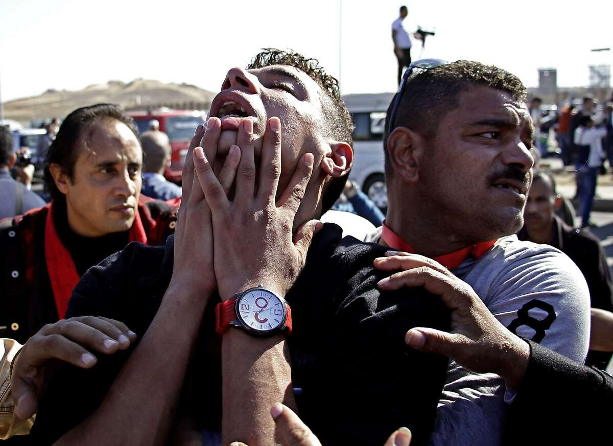 An anti-Hosni Mubarak protester reacts after hearing the verdict of the trial of the former Egyptian President outside a police academy on the outskirts of Cairo Saturday, Nov. 29, 2014. The court on Saturday dismissed murder charges against Mubarak in connection with the killing of protesters in the 2011 uprising that ended his nearly three-decade reign. (AP Photo/Ahmed Abd El-Latif, El Shorouk Newspaper) EGYPT OUT