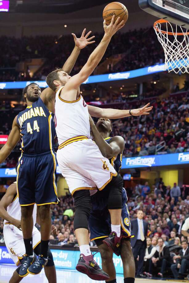 CLEVELAND, OH - NOVEMBER 29: Solomon Hill #44 of the Indiana Pacers tries to block Kevin Love #0 of the Cleveland Cavaliers during the first half at Quicken Loans Arena on November 29, 2014 in Cleveland, Ohio. NOTE TO USER: User expressly acknowledges and agrees that, by downloading and or using this photograph, User is consenting to the terms and conditions of the Getty Images License Agreement. (Photo by Jason Miller/Getty Images) ORG XMIT: 508084653 Photo: Jason Miller / 2014 Getty Images