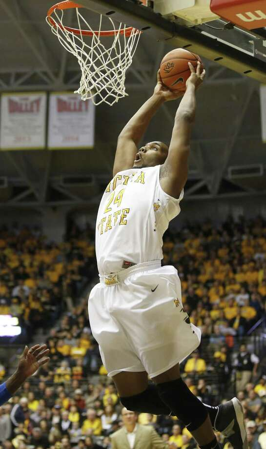 Wichita State forward Shaquille Morris dunks the ball in the second half of an NCAA college basketball game against Tulsa on Saturday, Nov. 29, 2014, in Wichita, Kan.  (AP Photo/The Wichita Eagle, Jaime Green)   ORG XMIT: KSWIE104 Photo: Jaime Green / The Wichita Eagle