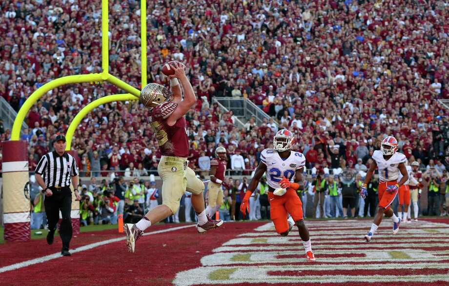 TALLAHASSEE, FL - NOVEMBER 29:  Nick O'Leary #35 of the Florida State Seminoles catches a touchdown  during a game against the Florida Gators  at Doak Campbell Stadium on November 29, 2014 in Tallahassee, Florida.  (Photo by Mike Ehrmann/Getty Images) ORG XMIT: 518727981 Photo: Mike Ehrmann / 2014 Getty Images
