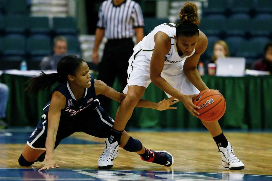 Connecticut's guard Moriah Jefferson, left, attacks after the ball from Vanderbilt's guard Paris Kea during the second half Saturday, Nov. 28, 2014 at Germain Arena in Estero, Fla. The University of Connecticut faced off against Vanderbilt in the Gulf Coast Showcase women's basketball tournament. UConn downed Vandy 91-52. Tomorrow the Huskies face the University of Wisconsin-Green Bay in the finals. (AP Photo/Naples Daily News, Corey Perrine)  FORT MYERS OUT MAGS OUT Photo: Corey Perrine, AP / Associated Press