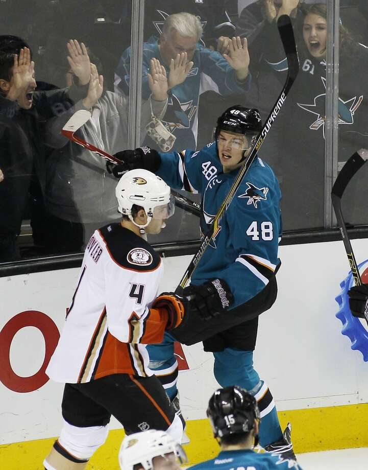 San Jose Sharks' Tomas Hertl (48) celebrates with fans after scoring a goal, as Anaheim Ducks' Brenden Dillon (4) skates by during the second period of an NHL hockey game, Saturday, Nov. 29, 2014, in San Jose, Calif. (AP Photo/George Nikitin) Photo: George Nikitin, Associated Press