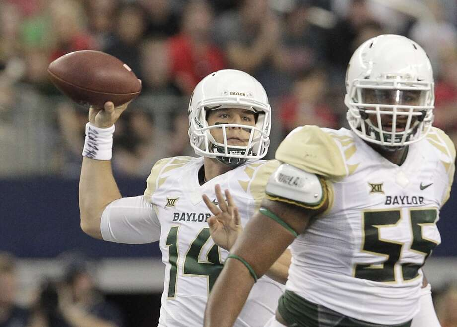 Baylor quarterback Bryce Petty (14) drops back to pass while offensive lineman Kyle Fuller gives protection in the first half of an NCAA college football game against Texas Tech, Saturday, Nov. 29, 2014, in Arlington, Texas. (AP Photo/Tim Sharp) Photo: Associated Press
