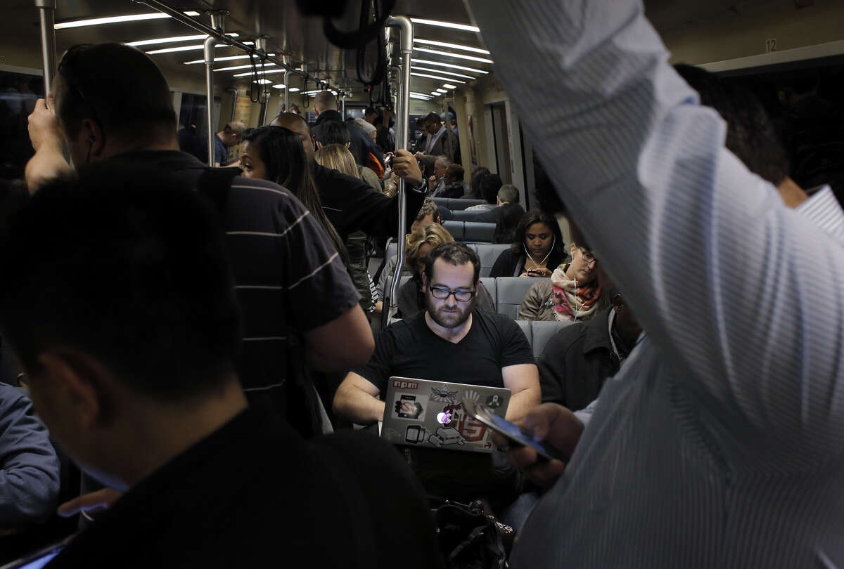 Lorin Beer of Pleasant Hill settles into his BART seat after riding