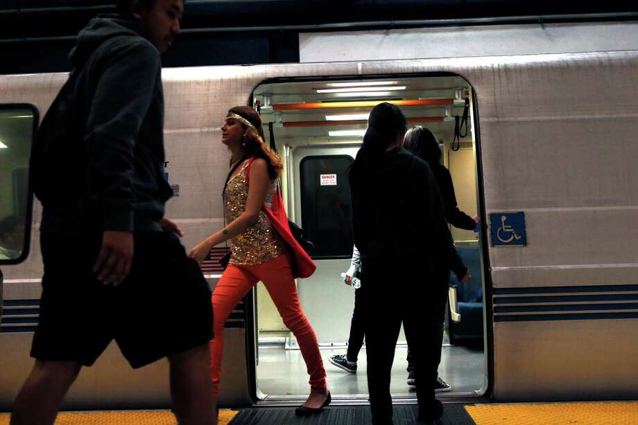 In this file photo, commuters enter and exit a train at Civic Center BART station in San Francisco. Photo: Scott Strazzante / The Chronicle / ONLINE_YES