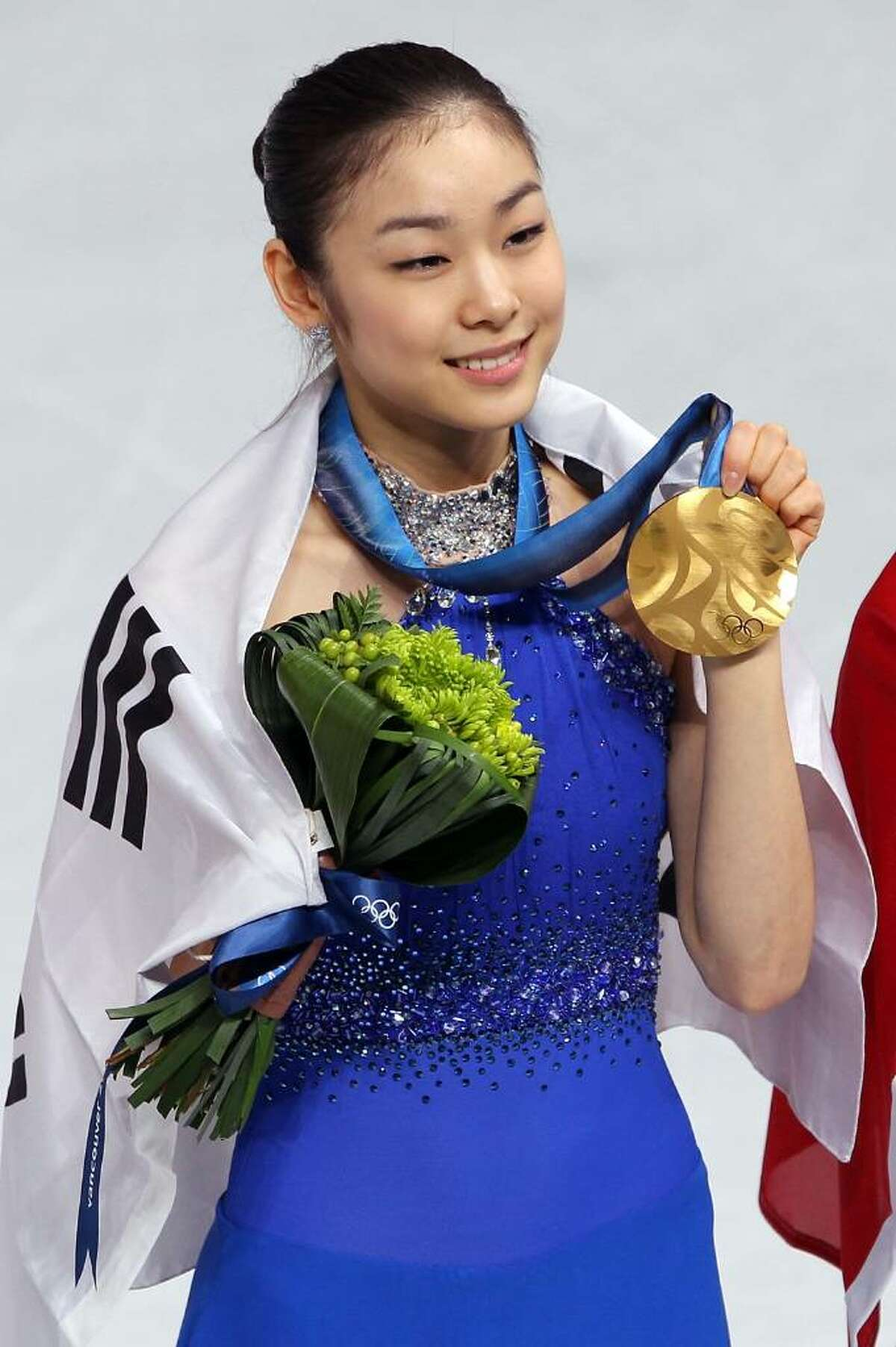 VANCOUVER, BC - FEBRUARY 25: Kim Yu-Na of South Korea celebrates winning the gold medal in the Ladies Free Skating during the medal ceremony on day 14 of the 2010 Vancouver Winter Olympics at Pacific Coliseum on February 25, 2010 in Vancouver, Canada. (Photo by Matthew Stockman/Getty Images) *** Local Caption *** Kim Yu-Na