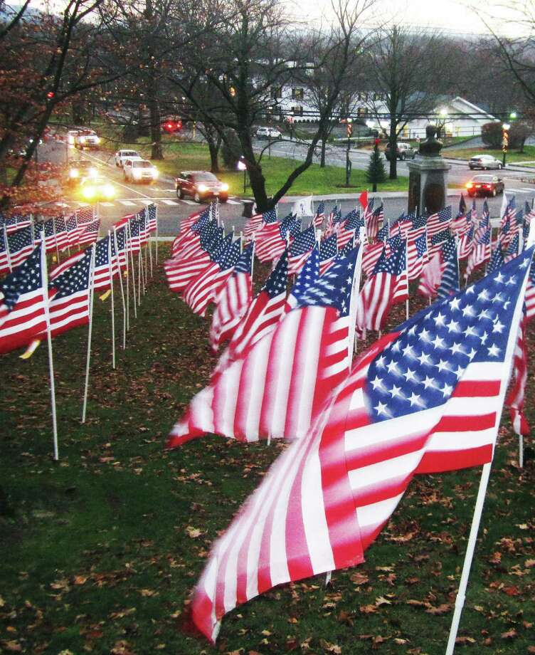 Hundreds of American flags are displayed on the hillside just north of the Village Green in New Milford. The Flags of Valor were placed by the Kiwanis Club of Danbury in tribute to United States veterans. Many are individually sponsored by local businesses, or by families and friends of veterans and those now serving in the American military. The flags will be exhibited through Pearl Harbor Day, Sunday, Dec. 7. November 2014 Photo: Norm Cummings / The News-Times
