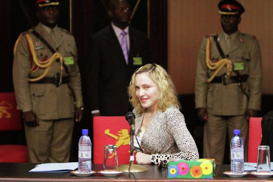 US singer Madonna, centre, is seen  at State House in Lillongwe  Malawi, Friday, Nov, 28, 2014, during her meeting with the Malawian President Peter Mutharika at State House. Mutharika thanked Madonna for agreeing to fund the construction of a new state of the art Paediatric Surgery and Intensive  Care Unit in  the country. Madonna is currently visiting Malawi, where she has been working since 2006 with her non profit organization, Raising Malawi. Photo: Tsvangirayi Mukwazhi, AP / AP