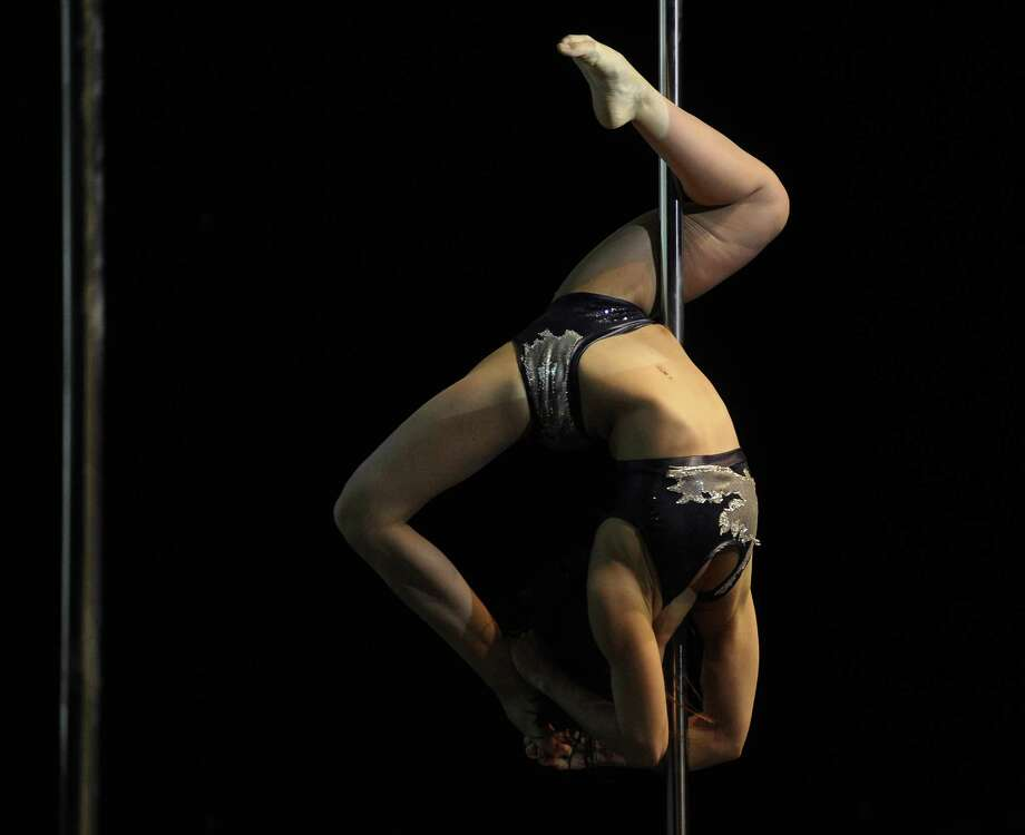 Brazilian pole dancer Alessandra Rancan competes in the South America 2014 Pole Dance competition in Buenos Aires on November 24, 2014. AFP PHOTO / Juan Mabromata Photo: JUAN MABROMATA, Getty Images / AFP