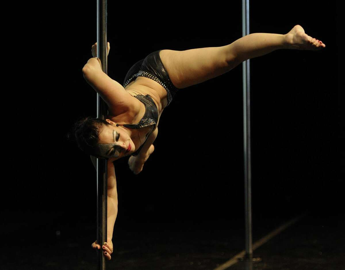 Chilean pole dancer Carolina Quinteros competes to get the third place in the South America 2014 Pole Dance competition in Buenos Aires on November 24, 2014. AFP PHOTO / Juan Mabromata