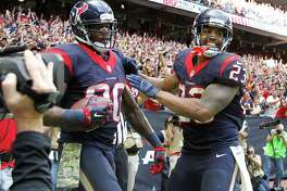 Houston Texans wide receiver Andre Johnson (80) celebrates his touchdown with Texans Arian Foster (23) during the fourth quarter at an NFL football game at NRG Stadium, Sunday, Nov. 30, 2014, in Houston.