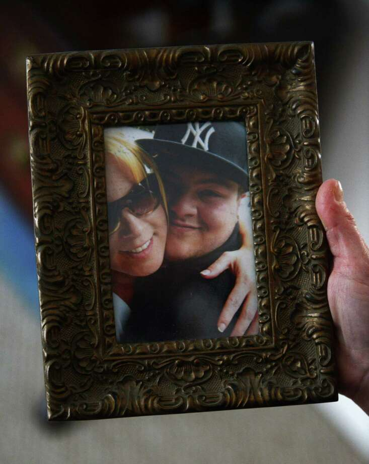 Kimberly Lepenga shows a picture of her with her son, Scott Lovito, inside her home in New Milford, Conn. Tuesday, Feb. 18, 2014.  Lepenga's son died summer 2013 at age 21 of a heroin overdose in which the drug was tainted with the synthetic opiate fentanyl. Photo: Tyler Sizemore / The News-Times