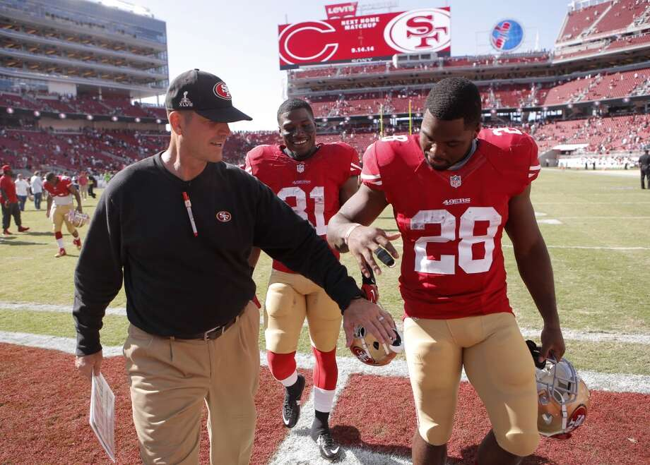 49er head coach Jim Harbaugh walks off after the win with Glenn WInston, (31) and Carlos Hyde, (28) as the San Francisco 49ers beat the San Diego Chargers 21-7  in pre-season NFL action at Levi's Stadium in Santa Clara, Calif., on Sunday Aug. 24, 2014. Photo: Michael Macor, The Chronicle