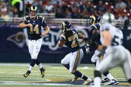 ST. LOUIS, MO - NOVEMBER 30: Shaun Hill #14 of the St. Louis Rams passes against the Oakland Raiders in the third quarter at the Edward Jones Dome on November 30, 2014 in St. Louis, Missouri.  The Rams beat the Raiders 52-0.  (Photo by Dilip Vishwanat/Getty Images)