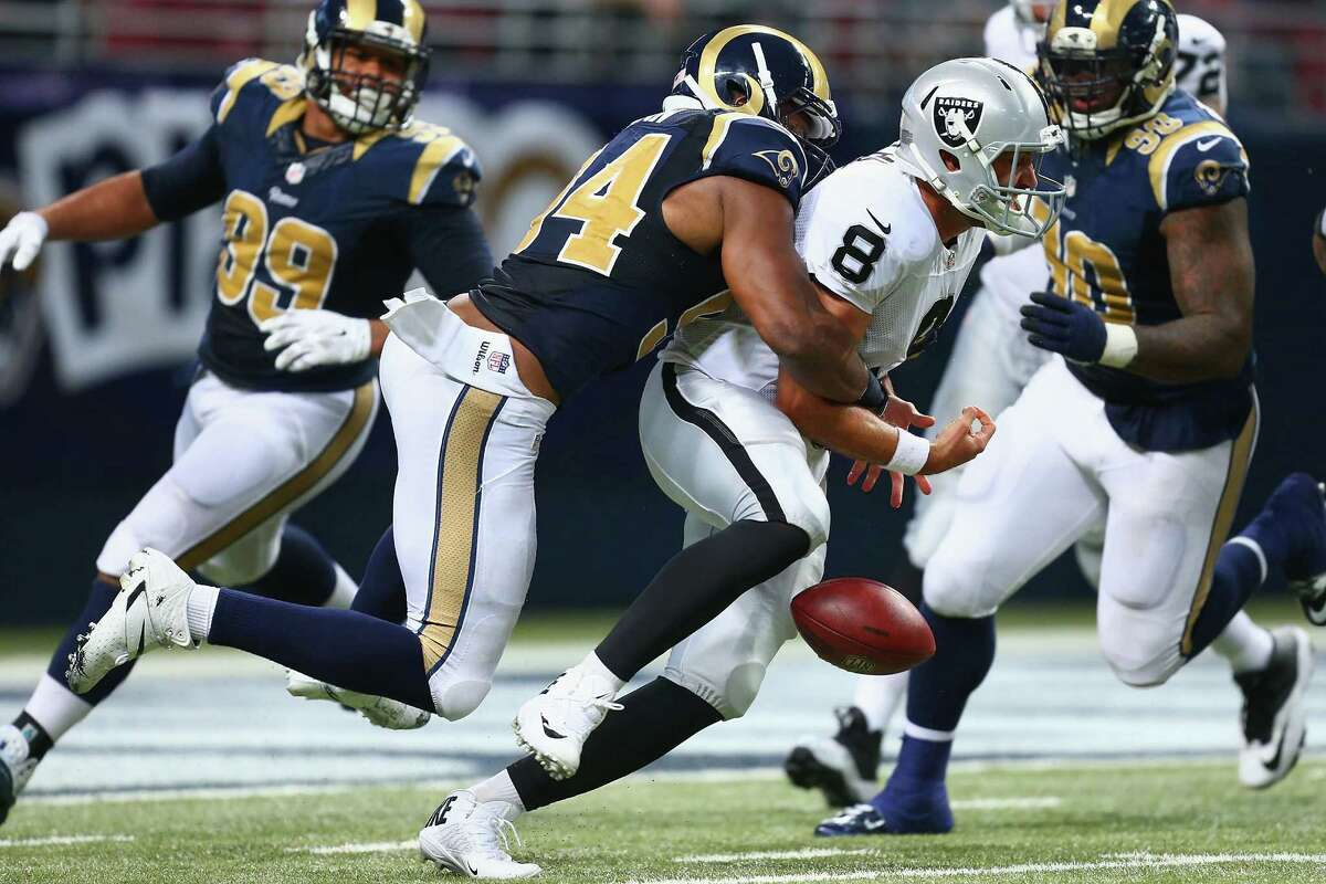 Matt Schaub (8) of the Raiders fumbles the ball after being sacked by the Rams in the fourth quarter on Nov. 30 in St. Louis. The Rams beat the Raiders 52-0.