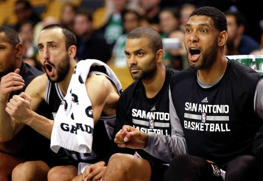 From left to right, San Antonio Spurs' Manu Ginobili, Tony Parker and Tim Duncan watch from the bench during the second half of their 111-89 win over the Boston Celtics in an NBA basketball game in Boston, Sunday, Nov. 30, 2014.