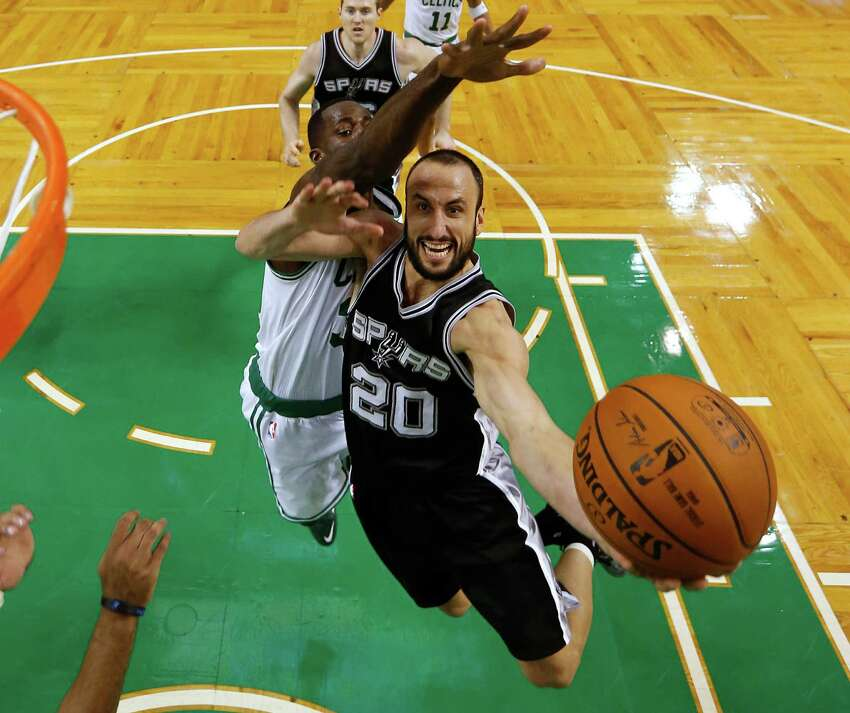 San Antonio Spurs' Manu Ginobili (20) drives to the basket past Boston Celtics' Brandon Bass during the second half of San Antonio's 111-89 win in an NBA basketball game in Boston, Sunday, Nov. 30, 2014.