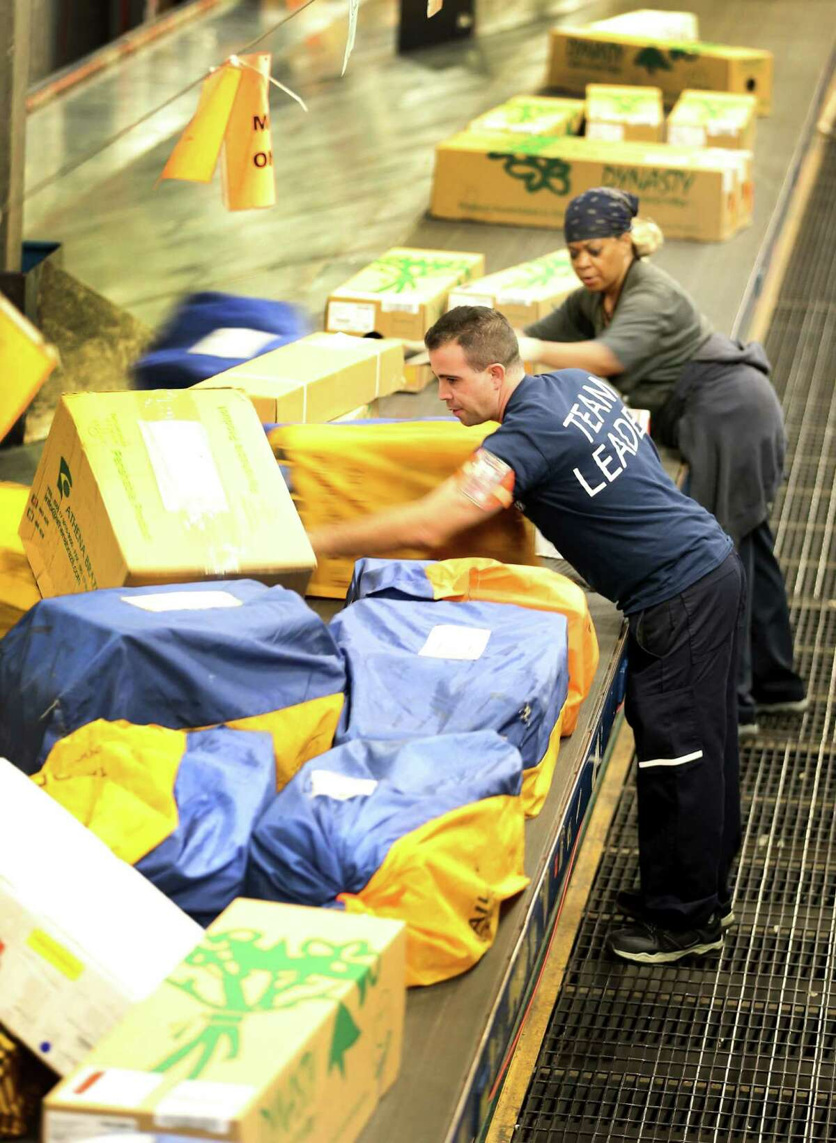 FedEx employees sort through packages at a shipping center that are heading out for delivery on last year's Cyber Monday, the top online spending day since researcher comScore Inc. began tracking online sales in 2001, posting $1.74 billion in sales, not including mobile sales.