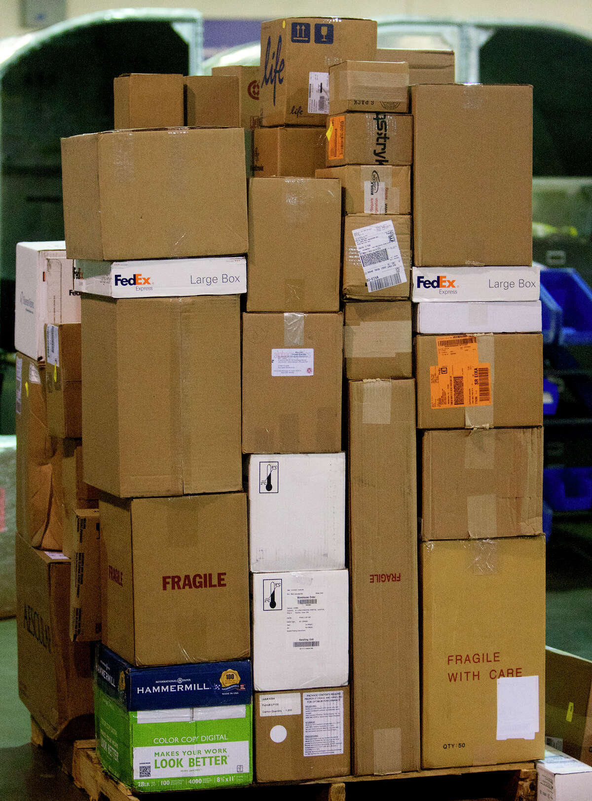 Packages wait to be delivered at FedEx's warehouse in Houston last year. A survey commissioned by Bankrate and compiled by Princeton Survey Research Associates International found that 25 percent of consumers plan to shop online Monday.