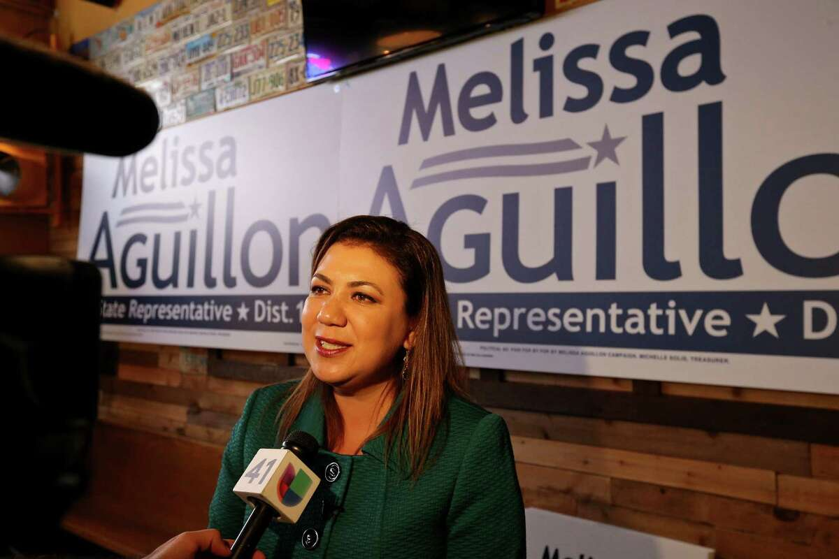 Melissa Aguillon, President and CEO of Aguillon & Associates LLC, answers questions from the media after announcing her candidacy for State Representatavie, District 123, Sunday Nov. 30, 2014 at Augie's Alamo City BBQ Steakhouse.