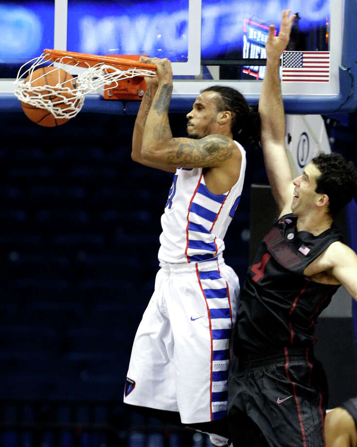 DePaul's Jamee Crockett dunks in the first half for two of his 19 points despite the efforts of Stanford center Stefan Nastic. Photo: Nam Y. Huh / Associated Press / AP