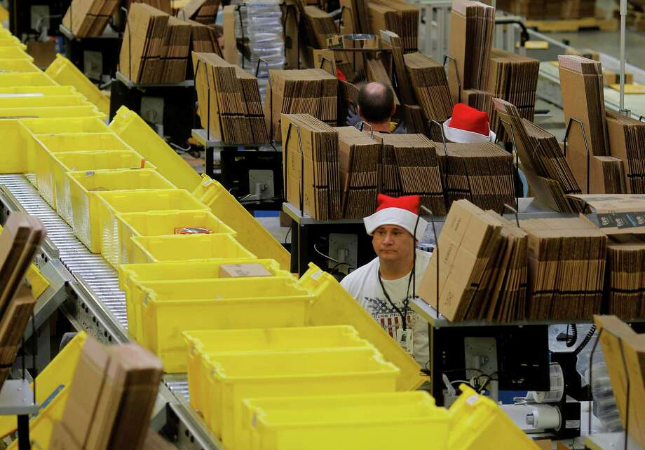Packers at the Amazon.com fulfillment center in Tracy get help from the newest robotic machinery. Photo: Brant Ward / The Chronicle / ONLINE_YES