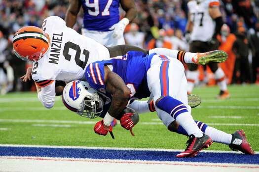 Nov. 30, 2014: Manziel dives in for a touchdown after replacing Cleveland Browns starting quarterback Brian Hoyer in the second half of the game against the Buffalo Bills. Photo: Gary Wiepert / FR170498 AP
