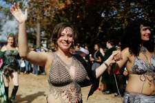 Festival actors parade through the crowd at the Texas Renaissance Festival Saturday, Nov. 29, 2014, in Todd Mission. Sunday is the last day for the festival this year.