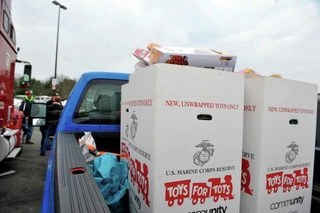 Toys are seen in boxes in the back of a pickup truck at the Convoy for Tots 2014 on Sunday, Nov. 30, 2014, in Wilton, N.Y.   The event was put on by the Capital Region Toys for Tots and the Saratoga County Sheriff's Office to collect more toys for the Toys for Tots program.  The convoy was made up of emergency services agencies from Saratoga County and members of the public who had a truck of any size and wanted to take part.  The convoy traveled through Saratoga Springs and ended up at the Saratoga County Sheriff's Office in Ballston Spa.  All those taking part in the convoy were asked to bring new, unwrapped toys.   (Paul Buckowski / Times Union) Photo: Paul Buckowski / 00029670A