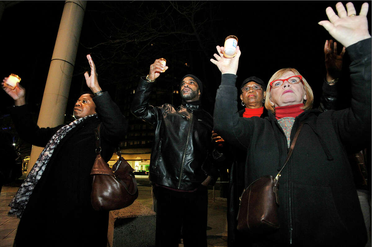 """The crowd joins in unison """"Hands up, don't shoot"""" from left: Gina Wynn, Scotty Schmidt, Ann Drakes and Bertilla Baker Thompson during the NAACP rally at the Stamford Government Center in Stamford, Conn., on Sunday, Nov. 30, 2014. The rally was in response to the St. Louis grand jury failing to indict Ferguson Police Officer Darren Wilson in the shooting death of Michael Brown Jr."""