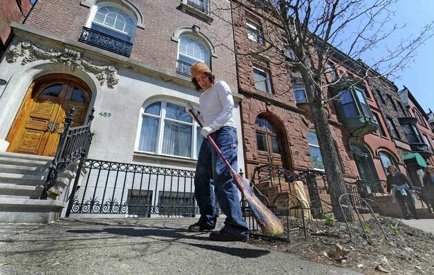 Susan D'Annibale sweeps the sidewalk in front of her residence on State Street in Albany, N.Y. on a beautiful spring day April 7, 2011. Photo: SKIP DICKSTEIN, TIMES UNION / 2008