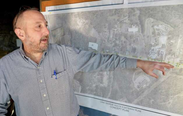 Town director of planning and zoning, Keith Oborne points out their Route 9 Gateway design on a concept plan at the Lake George Town Hall Wednesday Nov. 19, 2014, in Lake George, NY.  (John Carl D'Annibale / Times Union) Photo: John Carl D'Annibale / 00029526A