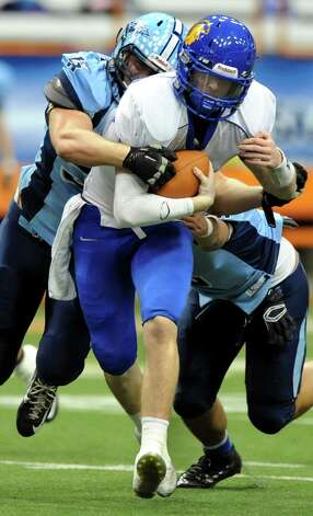Queensbury's quarterback Drew Wilson gets pressure from Indian River's defense during their Class A state football final on Sunday Nov. 30, 2014, at the Carrier Dome in Syracuse, N.Y. (Cindy Schultz / Times Union) Photo: Cindy Schultz / 00029663A