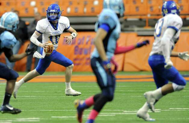 Queensbury's quarterback Drew Wilson, left, looks for an open man during their Class A state football final against Indian River on Sunday Nov. 30, 2014, at the Carrier Dome in Syracuse, N.Y. (Cindy Schultz / Times Union) Photo: Cindy Schultz / 00029663A