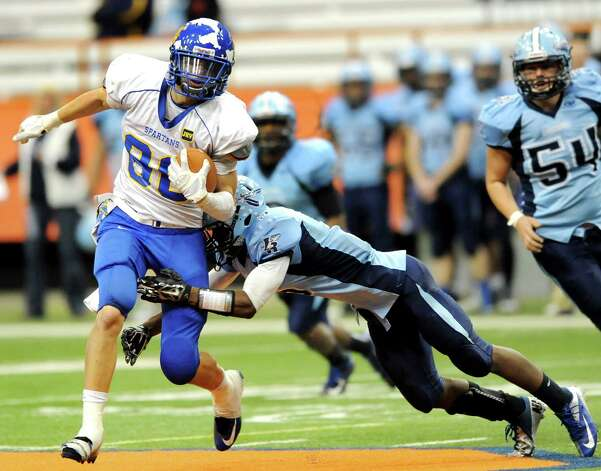 Queensbury's Keeghan O'Leary, left, shakes off a tackle from Indian River's Densel Barnes during their Class A state football final on Sunday Nov. 30, 2014, at the Carrier Dome in Syracuse, N.Y. (Cindy Schultz / Times Union) Photo: Cindy Schultz / 00029663A