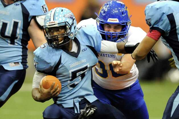 Queensbury's Sean Doran, right, pressures Indian River's quarterback Densel Barnes during their Class A state football final on Sunday Nov. 30, 2014, at the Carrier Dome in Syracuse, N.Y. (Cindy Schultz / Times Union) Photo: Cindy Schultz / 00029663A