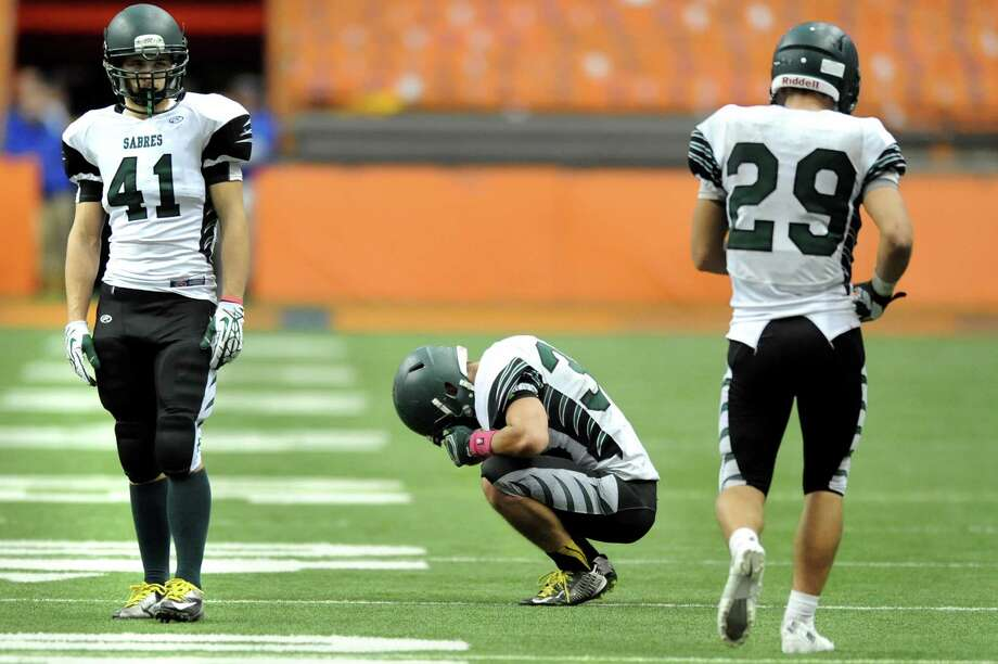 Schalmont's quarterback Nick Gallo, center, recovers from throwing an interception late in their Class B state football final against Maine-Endwell on Sunday Nov. 30, 2014, at the Carrier Dome in Syracuse, N.Y. Also reacting are teammates Nicholas Langenbach, left, and Kyle Strube. Maine-Endwell wins 27-19. (Cindy Schultz / Times Union) Photo: Cindy Schultz / 00029662A