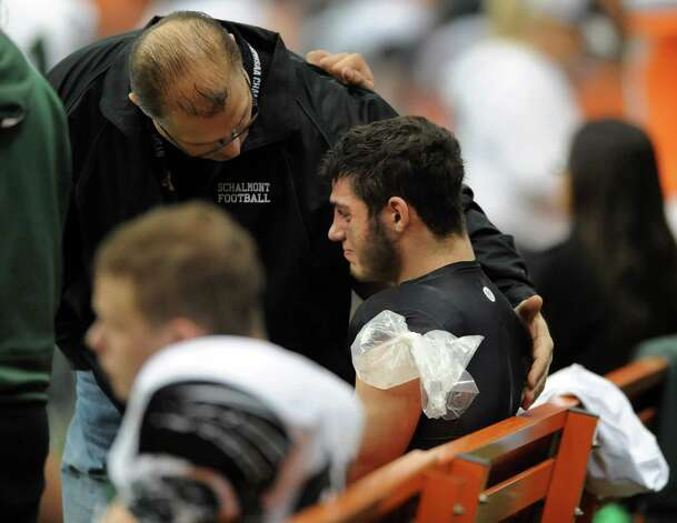 Schalmont's quarterback Nick Gallo, center, is consoled by his father, athletic director John Gallo, after a game-ending injury for Gallo in their Class B state football final against Maine-Endwell on Sunday Nov. 30, 2014, at the Carrier Dome in Syracuse, N.Y. Maine-Endwell wins 27-19. (Cindy Schultz / Times Union) Photo: Cindy Schultz / 00029662A