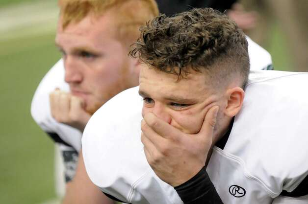 Schalmont's Anthony Yezzo, right, and Lucas Letarte react to their 27-19 loss to Maine-Endwell in their Class B state football final against Maine-Endwell on Sunday Nov. 30, 2014, at the Carrier Dome in Syracuse, N.Y. (Cindy Schultz / Times Union) Photo: Cindy Schultz / 00029662A