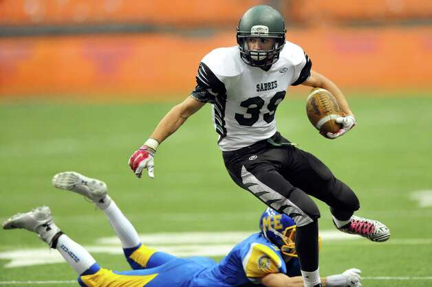 Schalmont's Hunter Gac, right, avoids a tackle from Maine-Endwell's Kevin Barrett during their Class B state football final on Sunday Nov. 30, 2014, at the Carrier Dome in Syracuse, N.Y. (Cindy Schultz / Times Union) Photo: Cindy Schultz / 00029662A