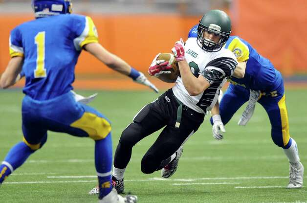 Schalmont's Hunter Gac, center, carries the ball as Maine-Endwell's Mike Palmer, left, and Kevin Barrett defend during their Class B state football final on Sunday Nov. 30, 2014, at the Carrier Dome in Syracuse, N.Y. (Cindy Schultz / Times Union) Photo: Cindy Schultz / 00029662A