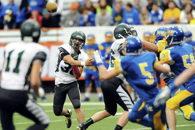 Schalmont's quarterback Nick Gallo, center, attempts a pass to Zac O'Dell, left, that's broken up during their Class B state football final against Maine-Endwell on Sunday Nov. 30, 2014, at the Carrier Dome in Syracuse, N.Y. (Cindy Schultz / Times Union) Photo: Cindy Schultz / 00029662A