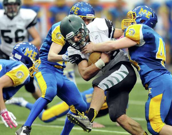 Schalmont's quarterback Nick Gallo, center, charges into a pack of Maine-Endwell defenders during their Class B state football final against Maine-Endwell on Sunday Nov. 30, 2014, at the Carrier Dome in Syracuse, N.Y. (Cindy Schultz / Times Union) Photo: Cindy Schultz / 00029662A