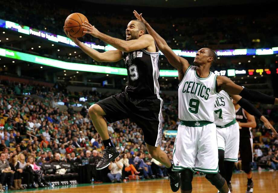 Tony Parker drives past Rajon Rondo during the second half. Photo: Winslow Townson, FRE / Associated Press / FR170221 AP